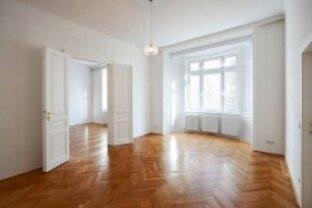 Vermietung topadaptierter 108m² Altbaumietwohnungen mit Balkon, Wohnzimmer mit Erker, 3 Schlafzimmer und möblierter Küche.
