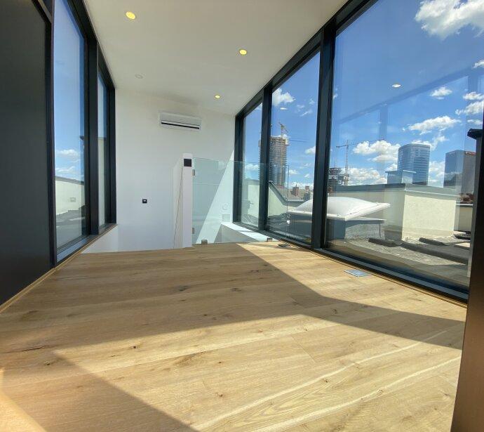 Dachgeschoß-Wohnung mit 2 Terrassen und Wintergarten