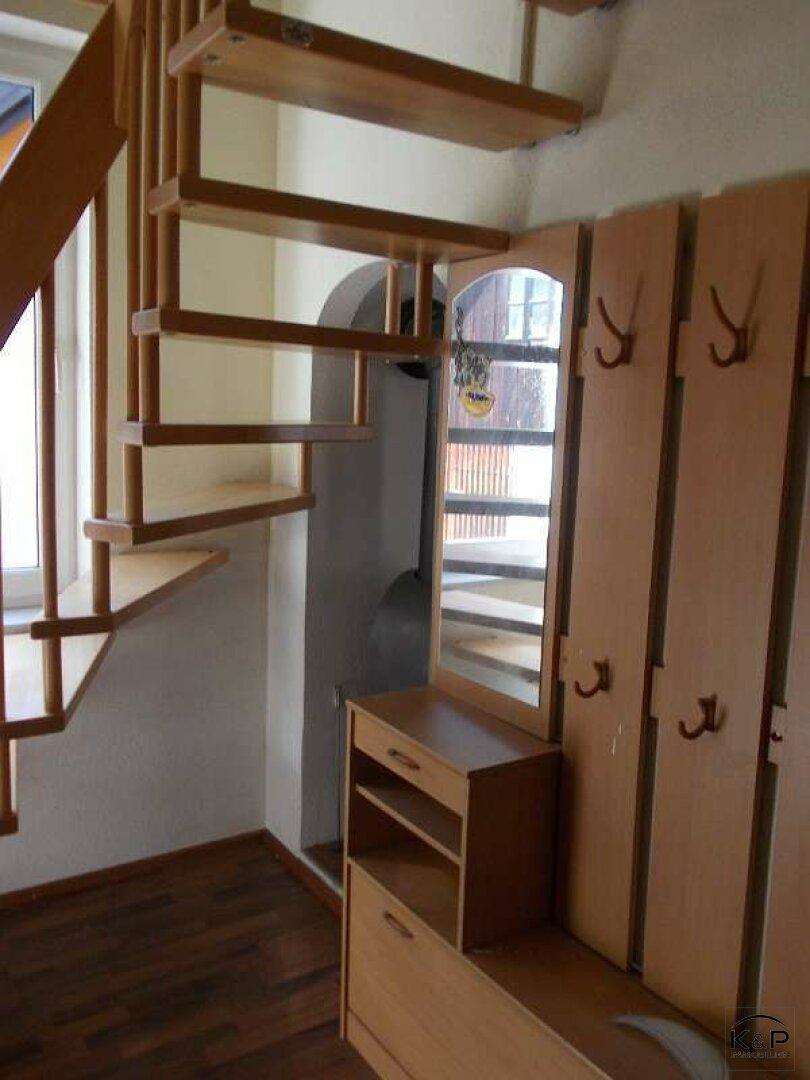 Garderobe und Aufgang Dachgeschoß