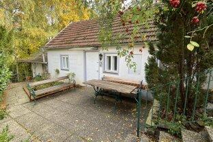 Einfamilienhaus in Ruhelage mit Erdkeller, Innenhof, Garage und Garten zu kaufen!