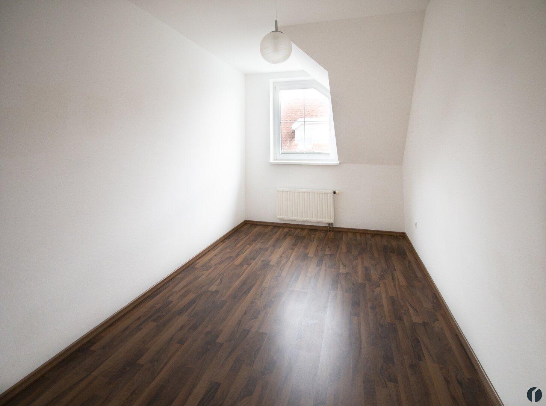 zweites Schlafzimmer in der oberen Etage