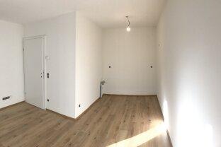 GARTENWOHNUNG 1-Zimmer-Wohnung im Erdgeschoss mit PKW-Freistellplatz ERSTBEZUG