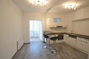 Großzügige Wohnung mit moderner Küche, ruhigem Schlafzimmer und großem Wohnzimmer