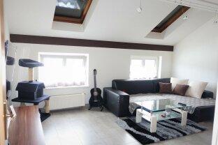 Besonderheit -DG-Wohnung mit Garage und separatem Hobbyraum, interessiert?