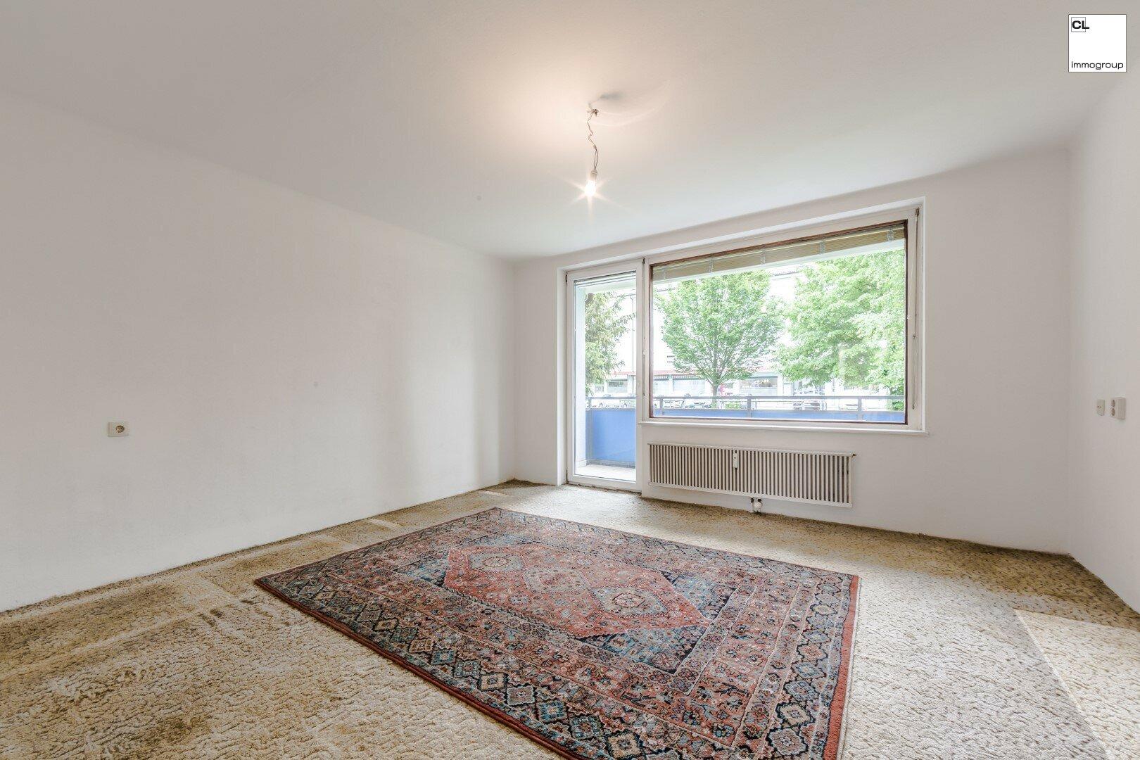 Großes Wohnzimmer von ruhigen 3-Zimmer-Wohnung in Salzburg zu kaufen www.cl-immogroup.at