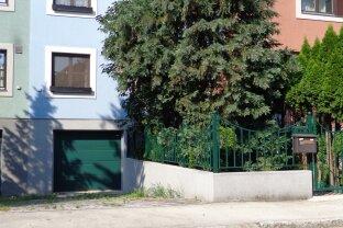 Reihenhaus unterkellert,mit Garage,Terrasse und Garten