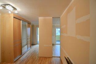 2-Zimmer Neubauwohnung mit hofseitigem Balkon, Garagenplatz inklusive