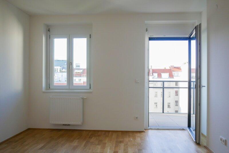 Wohnküche und Balkon hofseitig