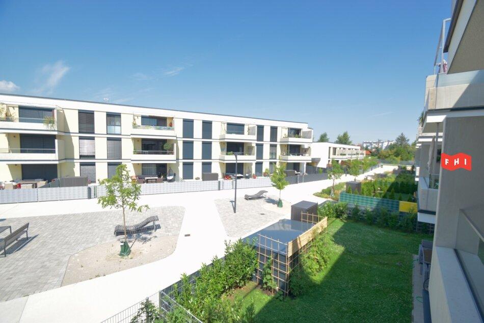 Sonnige 2-Zimmer Wohnung mit Terrasse, Tiefgaragenplatz und Gartenblick