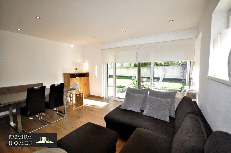 REITH I.A. _ 3 Zimmer Eigentumswohnung _ Sonnige Ausrichtung mitGarten_Wohnzimmer mit Esstisch