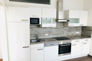 Großzügige 2-Zimmer Wohnung mit moderner Einbauküche und eigenem Parkplatz