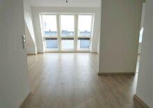 Erstbezug: 63m² DG-Wohnung mit Fernwärme Nähe U3 Enkplatz!
