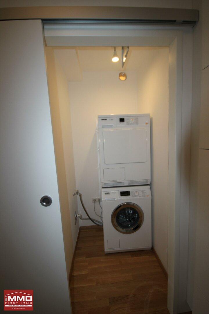 storeroom with washing machine and dryer