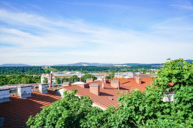 Foto von Terrassenwohnung mit Süd-West Terrassen und Glorietteblick !