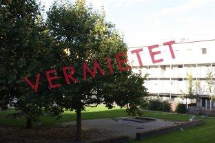 Helle 2-Zimmer-Wohnung mit Veranda - Zentral und doch im Grünen