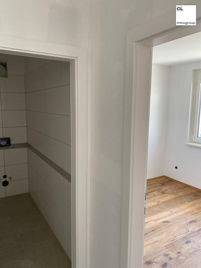 Bad und Schlafzimmer
