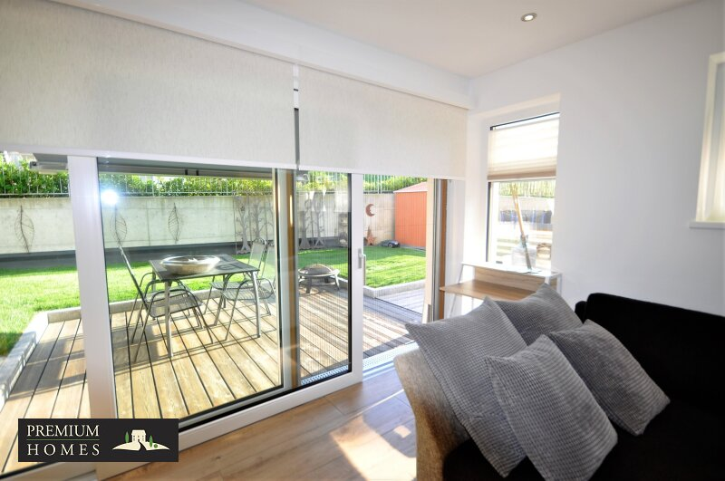 REITH I.A. _ 3 Zimmer Eigentumswohnung _ Sonnige Ausrichtung mitGarten_Wohnzimmer mit Terrassen_Zugang