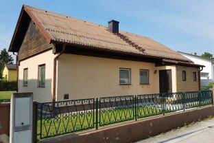 älteres Einfamilienhaus mit Garage in herrlicher Wohnlage