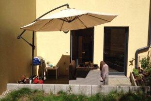 Tolle 2-Zimmer-Wohnung mit eigenem Garten! Supermarkt, Fitness und Garage im Haus!